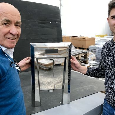 Valerio and Filippo Bolpagni proudly present the stainless steel front of a coffee machine