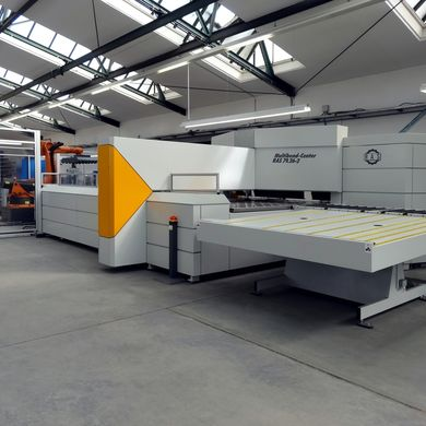 RAS Multibend-Center connected to an automated storage system. A loading robot provides the blanks.