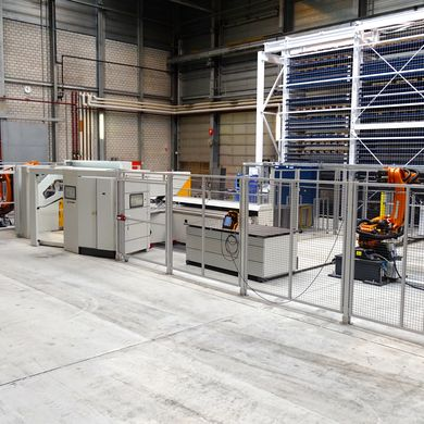 The automated storage system automatically delivers blanks to the panel bender
