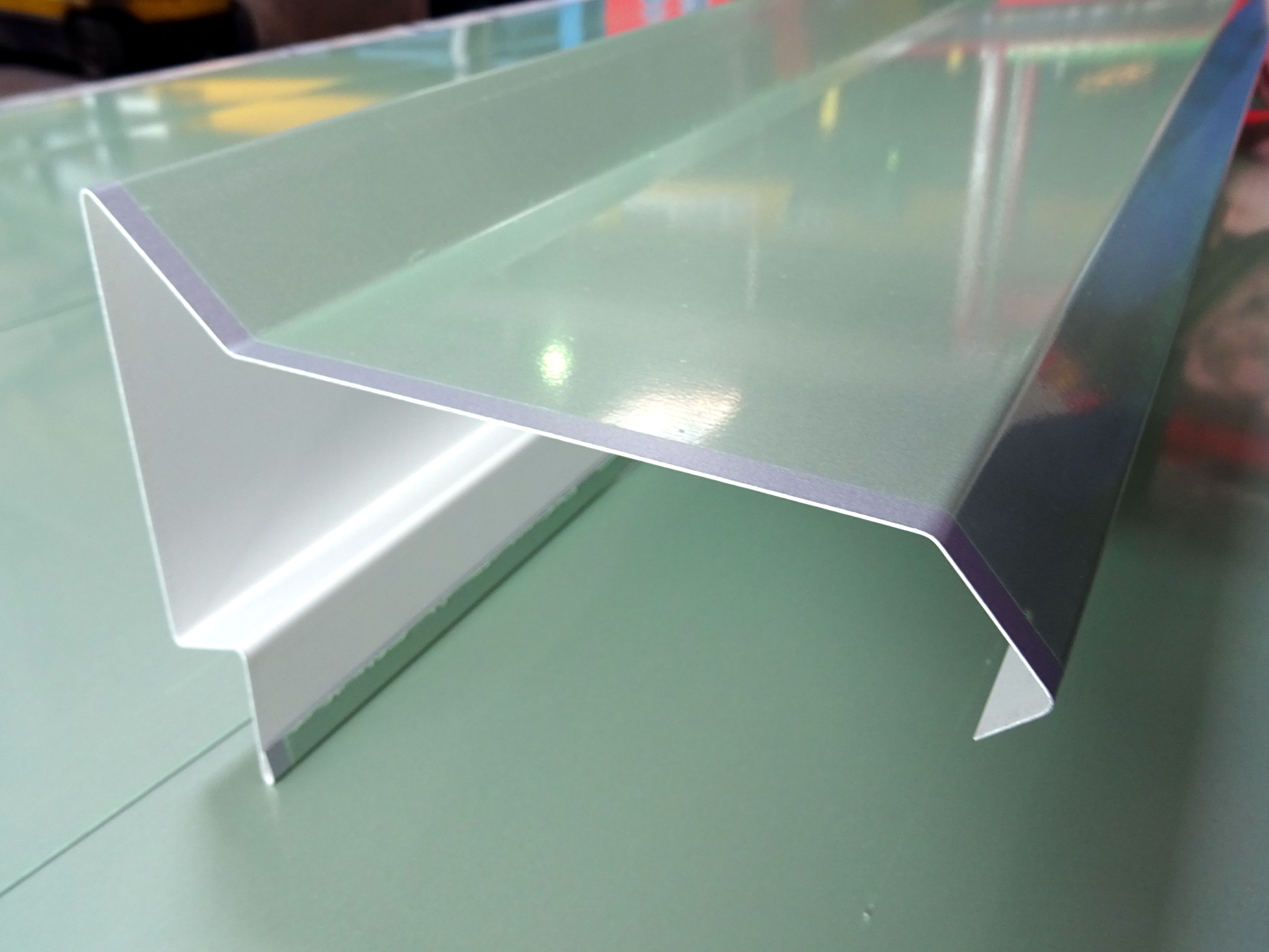 Folded flashing in coated aluminum